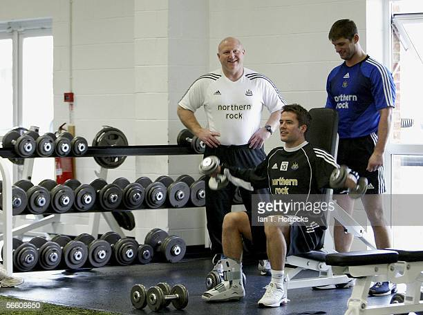 Michael Owen aided by club staff Derek Wright and John Huntley works in th gym on his first day back in training at Newcastle United after being...
