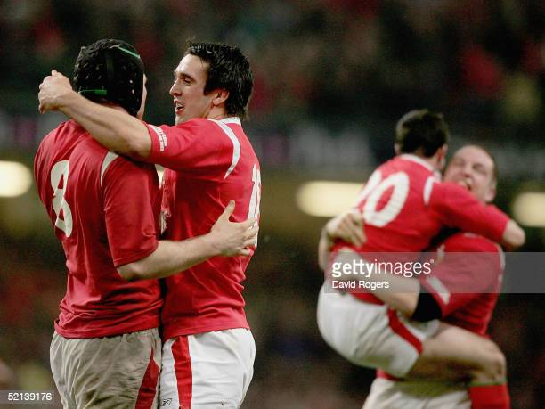 Michael Owen and Jonathan Thomas of Wales celebrate at the end of the RBS Six Nations match between Wales and England at the Millennium Stadium on...