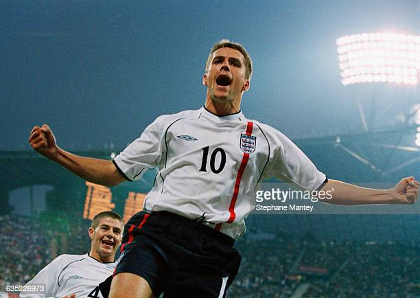 Michael Owen celebrates scoring a goal during a 2002 FIFA World Cup qualifying match against Germany England won 51