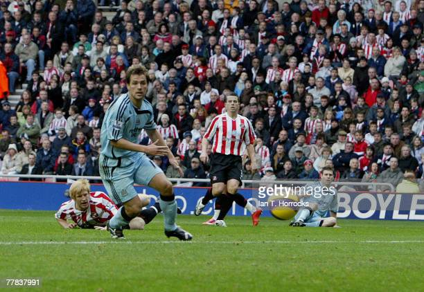 Michael Owen looks on as James Milner scores the first goal for Newcastle United during the Barclays Premier League match between Sunderland and...