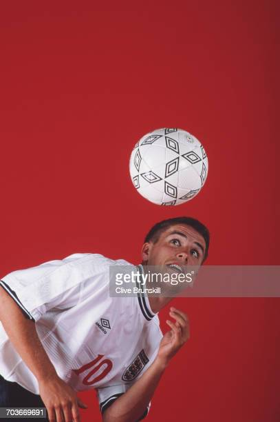 Michael Owen of England and Liverpool Football Club poses for a portrait for sports clothing & accessories company Umbro at the Worxx Studio on 18...