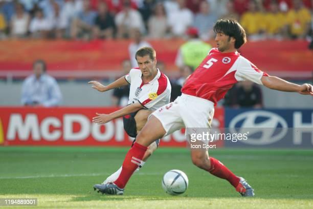 Michael OWEN of England and Murat YAKIN of Switzerland during the European Championship match between England and Switzerland at Estadio Cidade de...