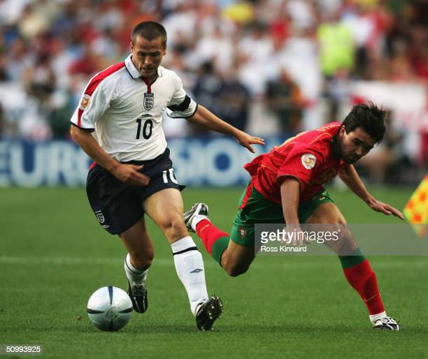 Michael Owen of England battles with Deco of Portugal during the UEFA Euro 2004 Quarter Final match between Portugal and England at the Luz Stadium...