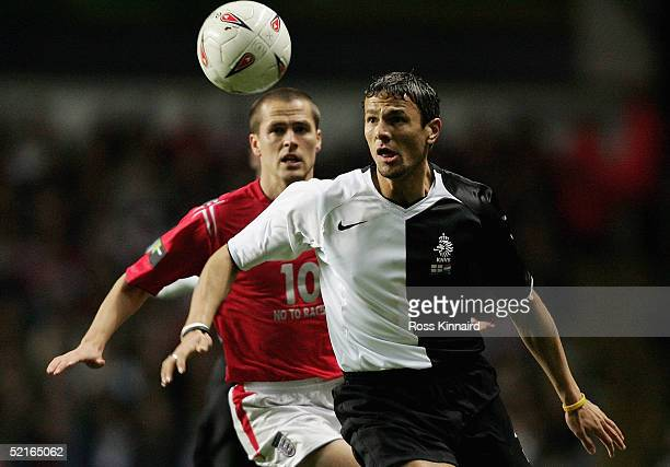 Michael Owen of England battles with Khalid Boulahrouz of Holland during the International Friendly match between England and Holland at Villa Park...