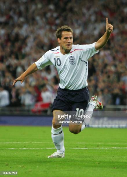 Michael Owen of England celebrates as he scores their first goal during the Euro 2008 qualifying match between England and Russia at Wembley Stadium...