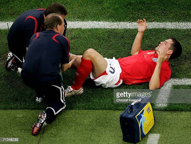 Michael Owen of England goes down injured during the FIFA World Cup Germany 2006 Group B match between Sweden and England at the Stadium Cologne on...