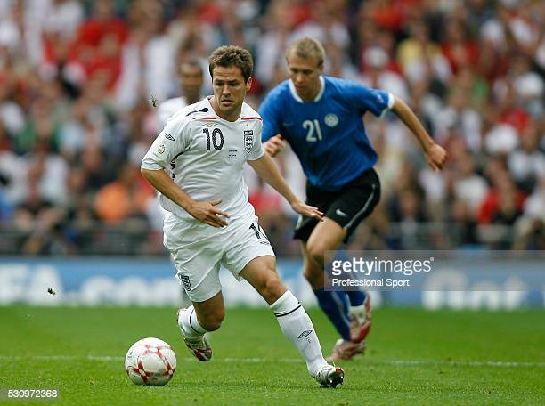 Michael Owen of England in action with Tavvi Rahn of Estonia behind during the England v Estonia EURO2008 Qualifing Match at Wembley Stadium London...
