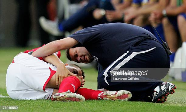 Michael Owen of England is seen to after going down injured during the FIFA World Cup Germany 2006 Group B match between Sweden and England at the...