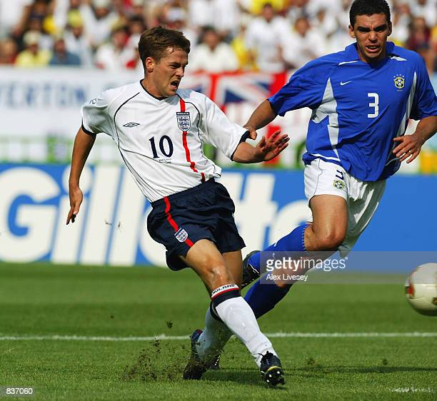 Michael Owen of England scores the opening goal of the match during the FIFA World Cup Finals 2002 Quarter Finals match between England and Brazil...