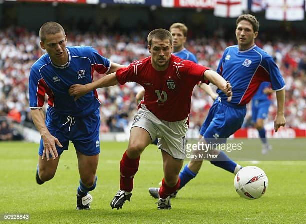 Michael Owen of England takes on the Iceland defence during the FA Summer Tournament match between England and Iceland at the City of Manchester...