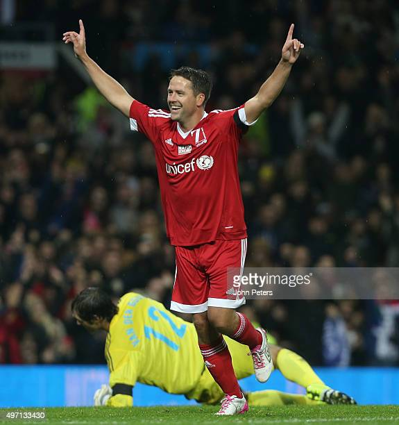 Michael Owen of Great Britain and Ireland celebrates scoring their second goal during the David Beckham Match for Children in aid of UNICEF between...