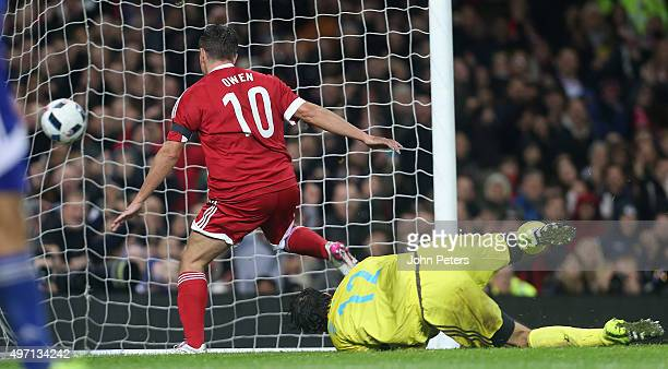 Michael Owen of Great Britain and Ireland scores their third goal during the David Beckham Match for Children in aid of UNICEF between Great Britain...