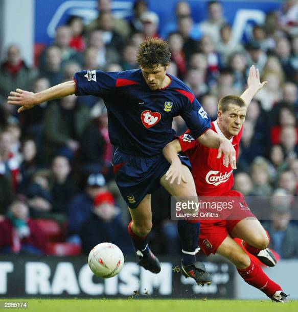 Michael Owen of Liverpool battles with Dejan Stefanovic of Portsmouth during the FA Cup Fifth Round match between Liverpool and Portsmouth at Anfield...