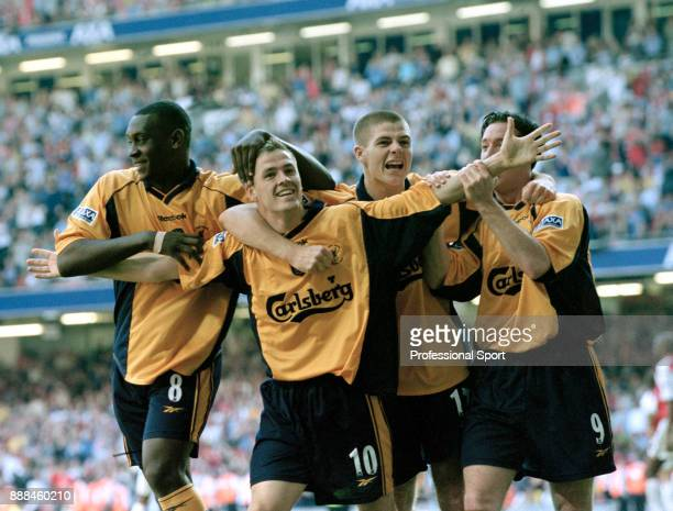 Michael Owen of Liverpool celebrates with team mates Emile Heskey Steven Gerrard and Robbie Fowler after scoring during the FA Cup Final between...