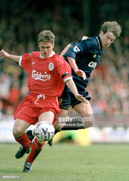 Michael Owen of Liverpool is challenged by Kenny Cunningham of Wimbledon during an FA Carling Premiership match at Selhurst Park on April 16 2000 in...