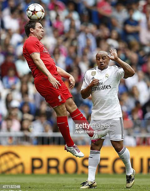 Michael Owen of Liverpool Legends heads the ball beside Roberto Carlos of Real Madrid Leyendas during the Corazon Classic charity match between Real...