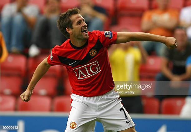 Michael Owen of Manchester United celebrates after scoring the 40 goal during the Barclays Premier League match between Wigan Athletic and Manchester...