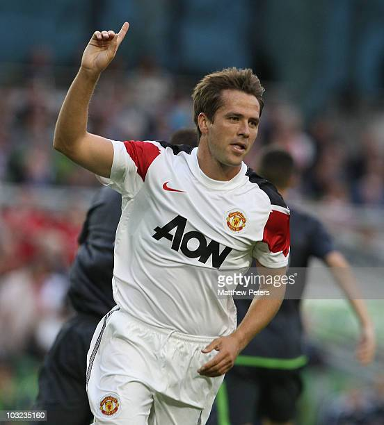 Michael Owen of Manchester United celebrates scoring their first goal during the preseason friendly match between Irish League XI and Manchester...