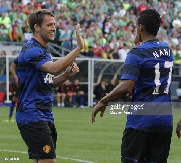 Michael Owen of Manchester United celebrates scoring their first goal during the pre-season friendly match between Seattle Sounders and Manchester...