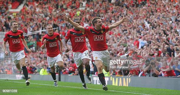Michael Owen of Manchester United celebrates scoring their fourth goal during the Barclays Premier League match between Manchester United and...