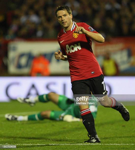 Michael Owen of Manchester United celebrates scoring their second goal during the Carling Cup fourth round match between Aldershot Town and...