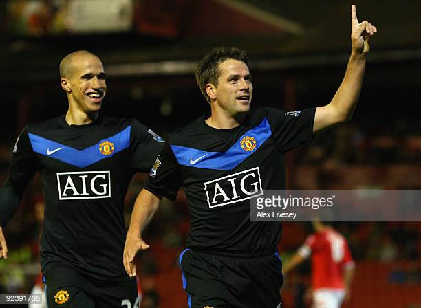 Michael Owen of Manchester United celebrates with Gabriel Obertan after scoring the second goal during the Carling Cup 4th Round match between...