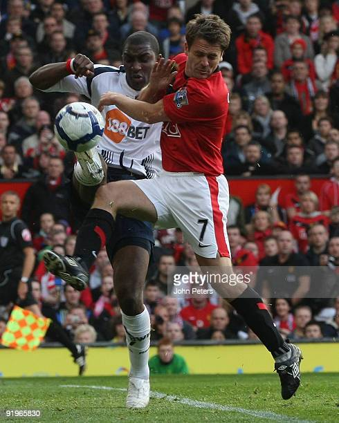 Michael Owen of Manchester United clashes with Jlloyd Samuel of Bolton Wanderers during the FA Barclays Premier League match between Manchester...