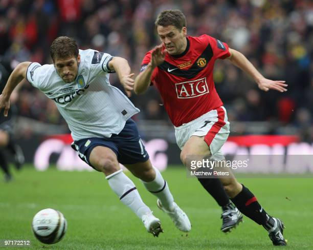 Michael Owen of Manchester United clashes with Stiliyan Petrov of Aston Villa during the Carling Cup Final match between Aston Villa and Manchester...