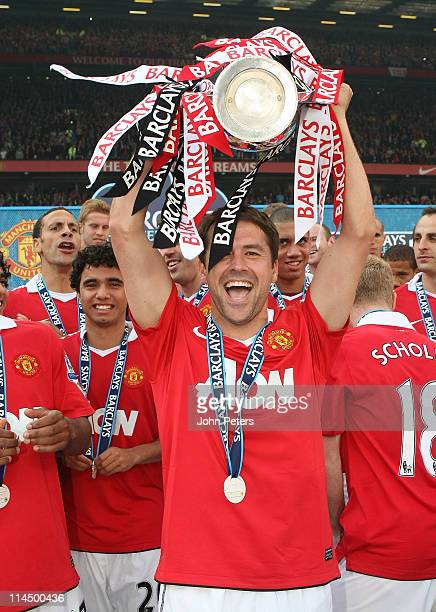 Michael Owen of Manchester United lifts the Barclays Premier League trophy after the Barclays Premier League match between Manchester United and...