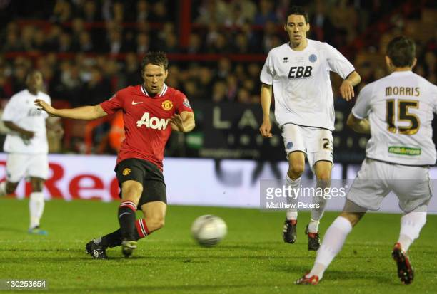 Michael Owen of Manchester United scores their second goal during the Carling Cup fourth round match between Aldershot Town and Manchester United at...