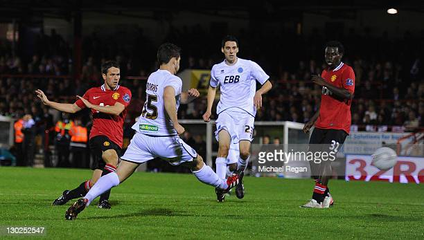 Michael Owen of Manchester United scores to make it 20 during the Carling Cup fourth round match between Aldershot Town and Manchester United at the...