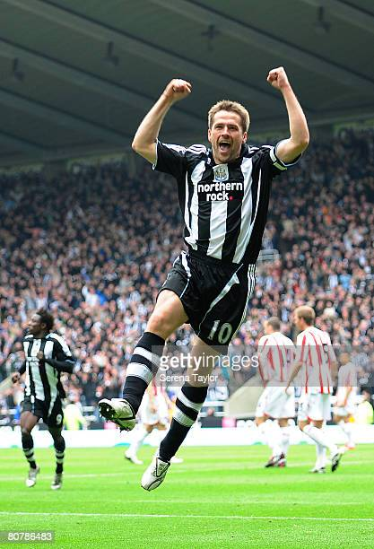 Michael Owen of Newcastle celebrates scoring the opening goal during the Barclays Premier League game between Newcastle United and Sunderland at St...