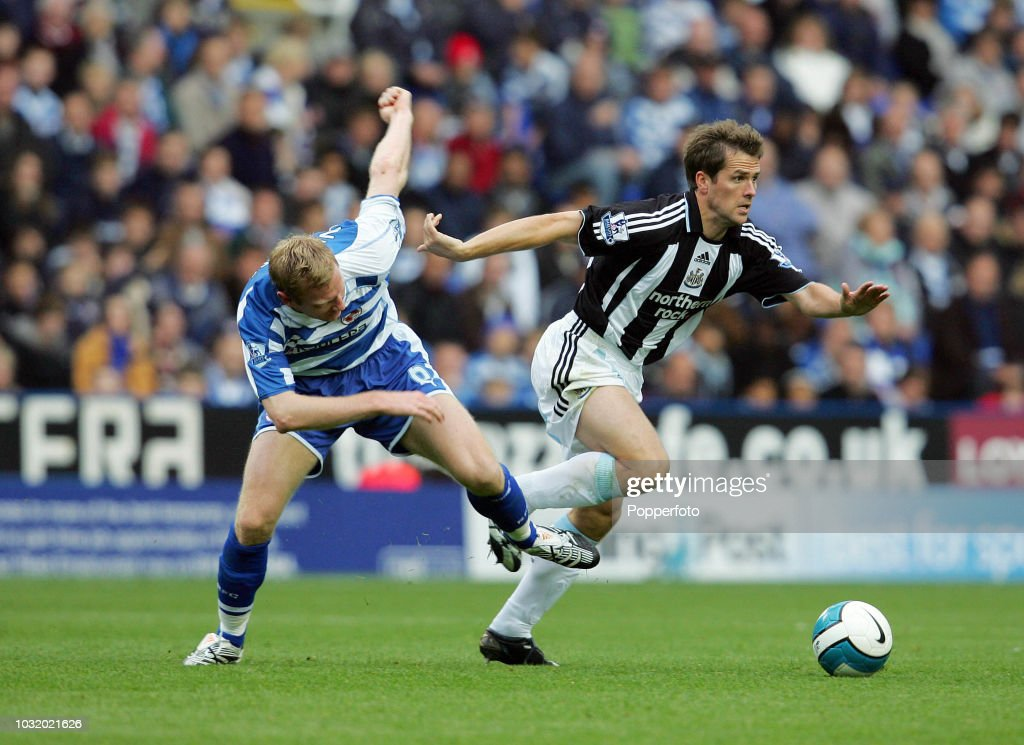 Michael Owen Of Newcastle Right Evading A Tackle By Brynjar Gunnarsson Of Reading During