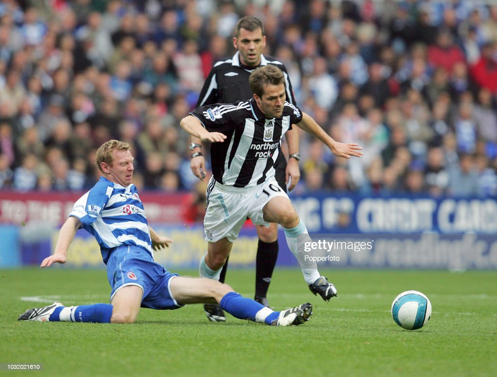 Michael Owen Of Newcastle Right Is Tackled By Brynjar Gunnarsson Of Reading During The
