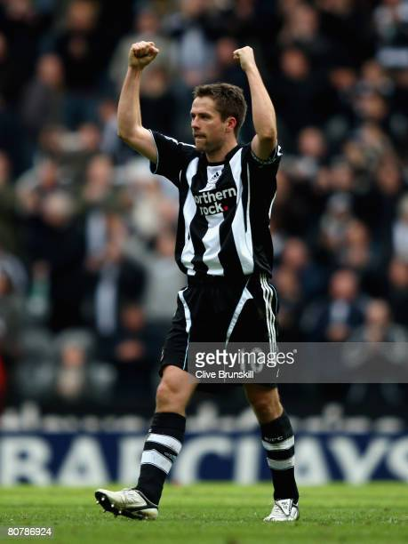 Michael Owen of Newcastle United celebrates at the final whistle after scoring the two goals in the Barclays Premier League match between Newcastle...