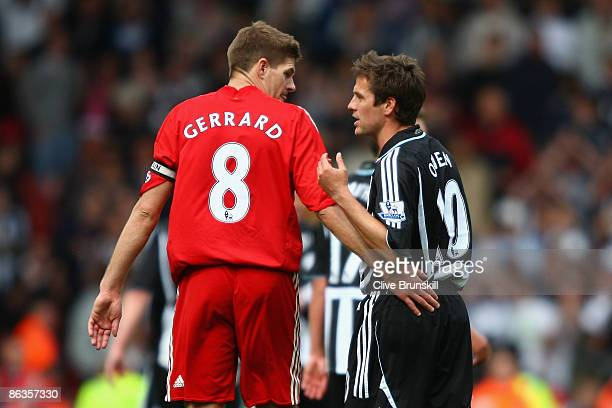 Michael Owen of Newcastle United chats with Steven Gerrard of Liverpool at the end of the Barclays Premier League match between Liverpool and...