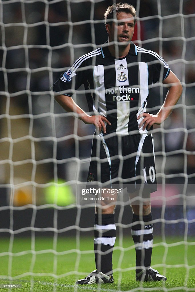 Michael Owen of Newcastle United shows his dejection during the Carling Cup Third Round match between Newcastle United and Tottenham Hotspur at St James' Park on September 24, 2008 in Newcastle, England.