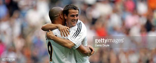Michael Owen of Real Madrid celebrates with Ronaldo after scoring a goal during a La Liga match between Real Madrid and Racing de Santander at the...