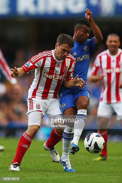 Michael Owen of Stoke City battles with Ashley Cole of Chelsea during the Barclays Premier League match between Chelsea and Stoke City at Stamford...