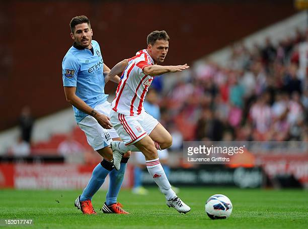 Michael Owen of Stoke City battles with Javi Garcia of Manchester City during the Barclays Premier League match between Stoke City and Manchester...