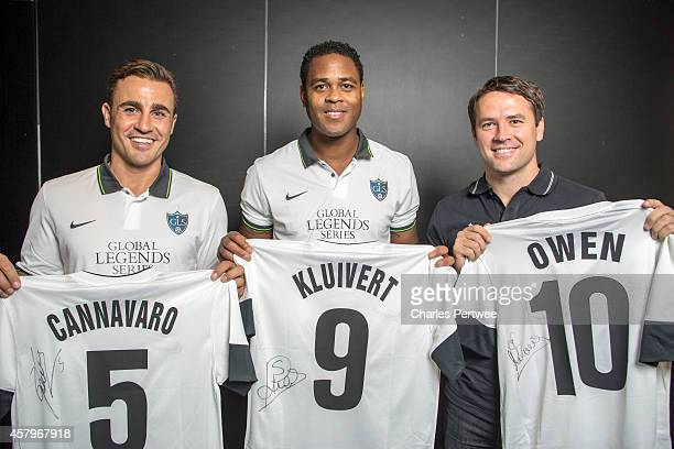 Michael Owen Patrick Kluivert and Fabio Cannavaro pose with tshirts at a Global Legends Series media event on October 27 2014 in Kuala Lumpur Malaysia