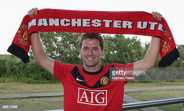 Michael Owen poses after signing for Manchester United at Carrington Training Ground on July 3 2009 in Manchester, England.