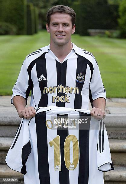 Michael Owen poses after signing for Newcastle United at his home on August 30, 2005 in North Wales.