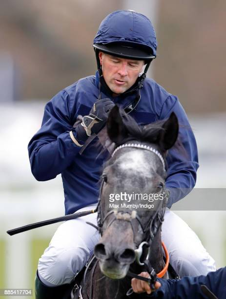 Michael Owen removes his goggles after riding 'Calder Prince' in The Prince's Countryside Fund Charity Race at Ascot Racecourse on November 24 2017...