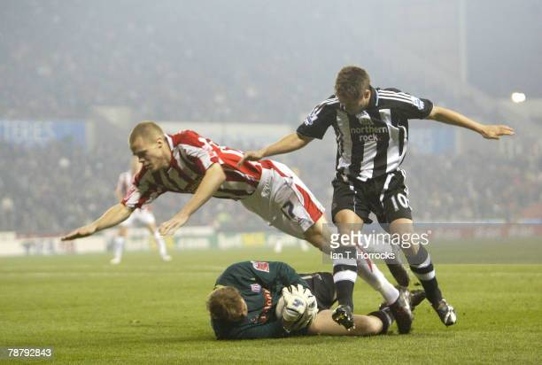 Michael Owen sees his shot saved by Steve Simonsen as Ryan Shawcross falls to the ground during the FA cup 3rd round tie at the Britannia Stadium,...