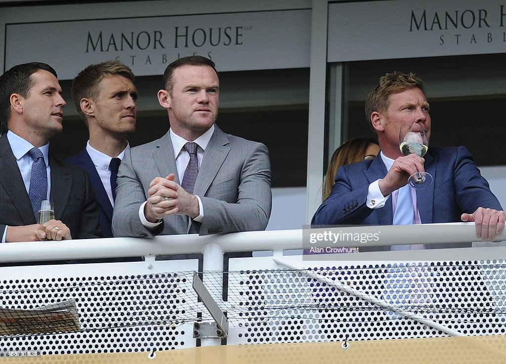 L-R, Michael Owen with Manchester United players Darren Fletcher and Wayne Rooney with trainer Tom Dascombe at Chester racecourse on May 08, 2014 in Chester, England.