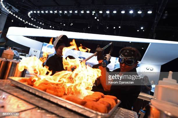 Michael Owens from Gastro Garage prepares desert using a blow torch for the media in the Infiniti booth during the auto trade show AutoMobility LA at...