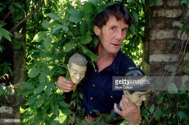 Michael Palin Actor and Author holds his favourite statuettes two miniature figures of Hollywood legends Stan Laurel left and Oliver Hardy as he...