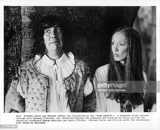 Michael Palin and Shelley Duvall look to their right in a scene from the film 'Time Bandits', 1981.