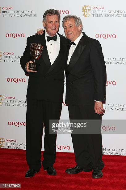 Michael Palin and Terry Jones pose in the press room at the Arqiva British Academy Television Awards 2013 at the Royal Festival Hall on May 12 2013...
